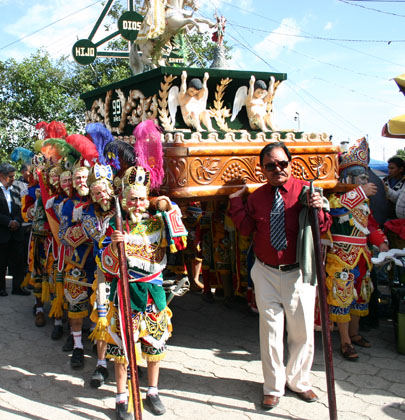 Dancers participating in the procession carrying the image of Santiago